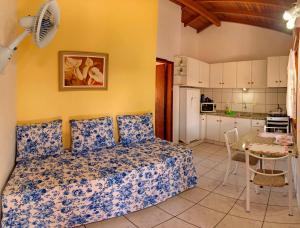 Cama ou camas em um quarto em Morada do Sol Apart Hotel
