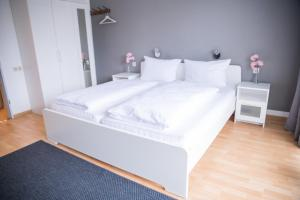 A bed or beds in a room at Römerhof