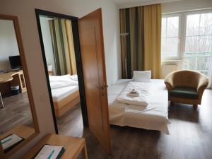 Ein Bett oder Betten in einem Zimmer der Unterkunft Hotel Xylophon inklusive Thermeneintritt