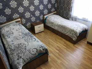 Cama ou camas em um quarto em Qabala SWEET Home