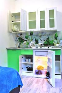 A kitchen or kitchenette at Апарт-Отель Весна