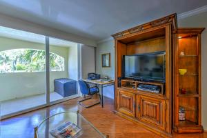 A television and/or entertainment centre at Marco Island Condo with Patio Steps to Beach Access
