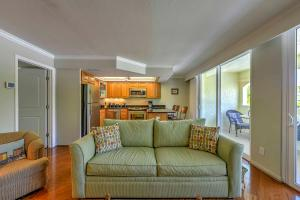 A seating area at Marco Island Condo with Patio Steps to Beach Access