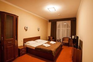 Ліжко або ліжка в номері Maria Garden hotel & restaurant