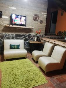 A television and/or entertainment center at HOTEL MONTE VERDE