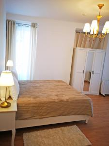 A bed or beds in a room at Safira