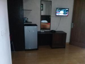 A kitchen or kitchenette at RF Hotel