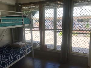 A bunk bed or bunk beds in a room at Hervey Bay Flashpackers