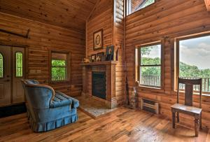 A seating area at Pastoral Log Cabin with Trails about 1Mi to Grand Lake