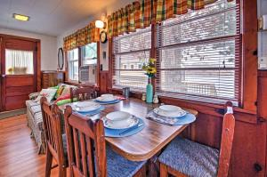 A restaurant or other place to eat at Cozy Camdenton Cottage with Deck and Boat Dock Access!