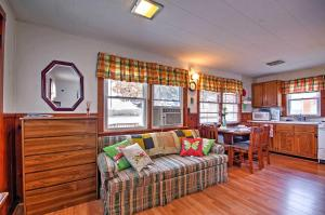 A seating area at Cozy Camdenton Cottage with Deck and Boat Dock Access!