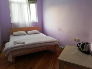 Cama ou camas em um quarto em Talha Hostel