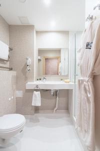 Ванная комната в Harbor Club Hotel