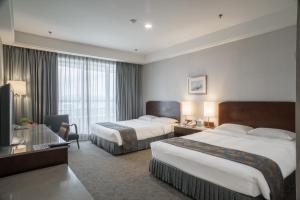 桃園翰品酒店房間的床