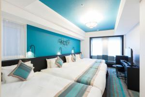 A bed or beds in a room at Hotel Dans Le Coeur Osaka Umeda