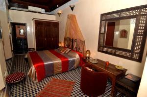 Un ou plusieurs lits dans un hébergement de l'établissement Riad Le Patio De Fes