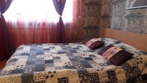 Кровать или кровати в номере Апартаменты Центр Тимирязева