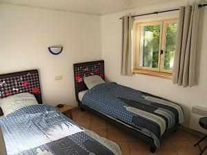A bed or beds in a room at Villa Le Bon Temps
