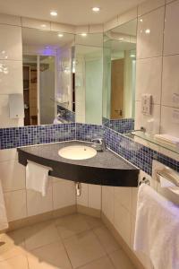 A bathroom at Holiday Inn Express Birmingham Redditch, an IHG Hotel