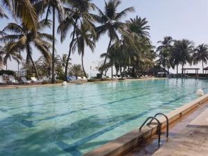 The swimming pool at or near Hotel Jardin Savana Dakar
