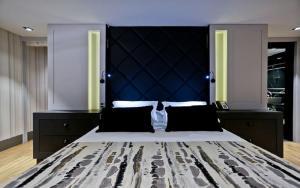 Cama ou camas em um quarto em Sandri Palace Hotel