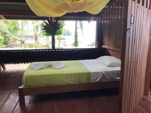 A bed or beds in a room at La Kuka