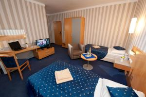 A television and/or entertainment center at Hotel Blue Bratislava