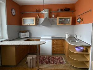 A kitchen or kitchenette at Apartmány Poliak