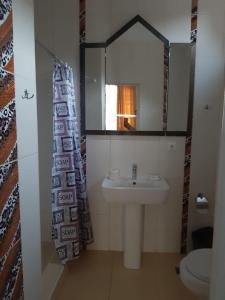 A bathroom at Fairy House Apartments & SPA