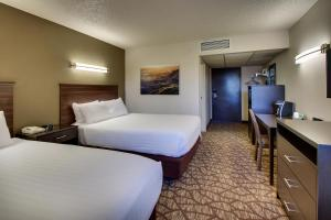 A bed or beds in a room at EverSpring Inn & Suites