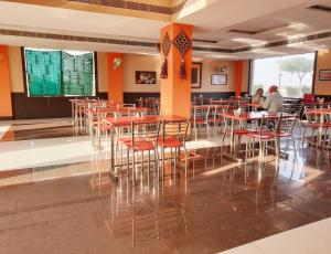 A restaurant or other place to eat at MPT Hotel Shubhim Highway Treat