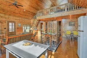 A restaurant or other place to eat at Greenfield Cabin with Screened-In Porch and Fire Pit!