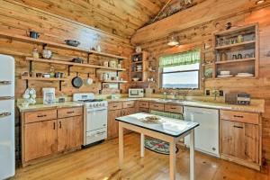 A kitchen or kitchenette at Greenfield Cabin with Screened-In Porch and Fire Pit!