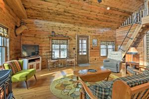 A seating area at Greenfield Cabin with Screened-In Porch and Fire Pit!