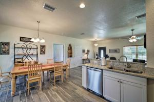 A kitchen or kitchenette at Spacious and Hip Crystal River Home with Dock and Kayaks!