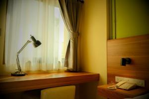 Een badkamer bij Siri Oriental Bangkok Hotel