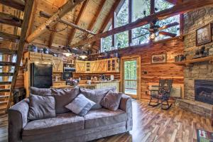 A seating area at Remote Cabin on 30 Acres with Dock and Private Lake!