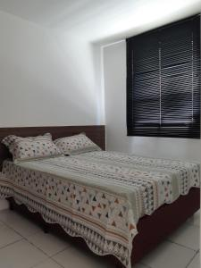 A bed or beds in a room at APARTAMENTO COMPLETO EM CAXIAS DO SUL - RS