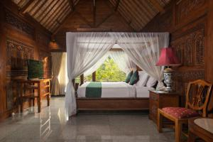 A bed or beds in a room at Ayung Resort Ubud