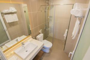 A bathroom at Mermaid Seaside Hotel