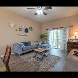 A seating area at Beautiful 3 Bedroom Apartment minutes from Disney!