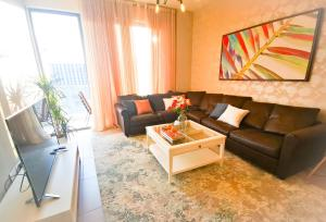 A seating area at Beach Front Sea View Apartment Families Only