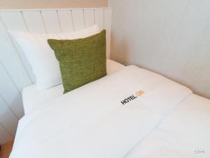 A bed or beds in a room at Hotel QB Dongdaemun Gallery