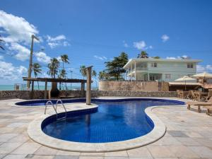 The swimming pool at or near Pousada Coqueiral