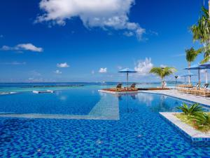 The swimming pool at or near SAii Lagoon Maldives, Curio Collection By Hilton