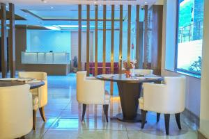 A restaurant or other place to eat at Ganpati Hotel Katra