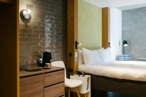 A bed or beds in a room at Market Street hotel