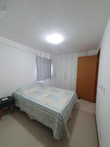 Cama ou camas em um quarto em Rosa Branca Facilities Apartamentos