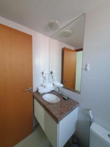 Um banheiro em Rosa Branca Facilities Apartamentos