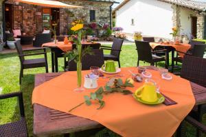 Restaurant ou autre lieu de restauration dans l'établissement Bio Agriturismo La Bellantiglia